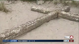 Barnacle-covered wooden cross washes up on Florida beach