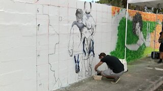 Artists revitalize historic Unity Wall in Lake Worth Beach