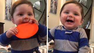 Adorable baby boy thinks the remote control is hysterical