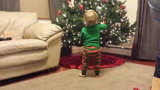 Baby elf helps decorate the Christmas tree