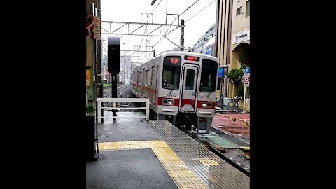 Local Tokyo Train Coming in Fast on Rainy Day at Tokiwadai Station on the Tobu Line in Itabashi