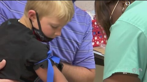 Kids 5 and up get shots in tests for COVID vaccine