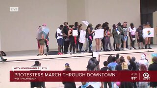 Protesters rally at Meyer Amphitheater in downtown West Palm Beach