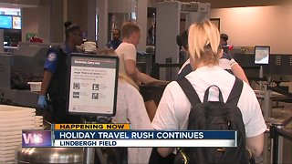 Holiday travel rush continues