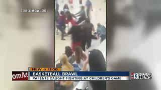Adults fight during kid's basketball game