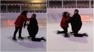 Woman falls during wedding proposal on ice skating rink