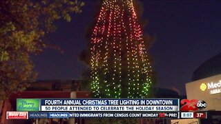 Community members gather in Central Bakersfield for tree lighting ceremony
