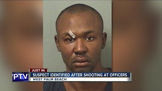 Police say they have identified the man accused of shooting at two officers