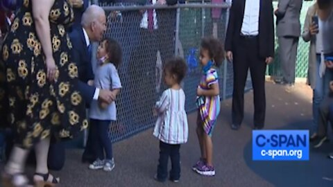 Biden hugs maskless children with no mask himself while protesters calling out Biden