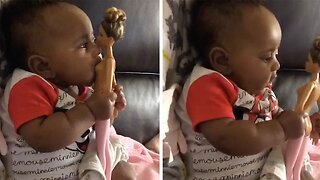 HUNGRY BABY TRIES TO BREASTFEED FROM BARBIE DOLL AS MUM LOOKS AFTER BROTHERS