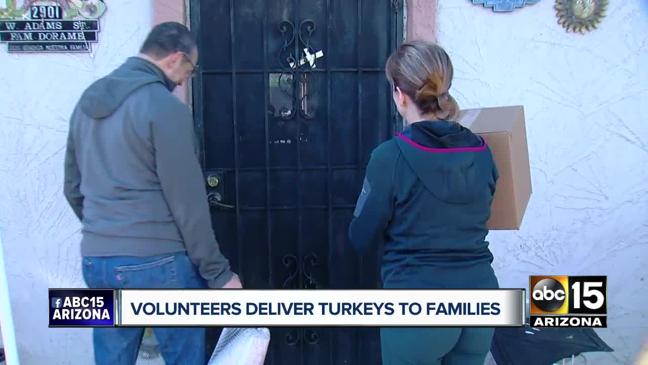 Phoenix Rescue Mission volunteers deliver turkeys to families