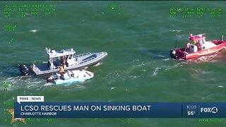 Man rescued from sinking boat