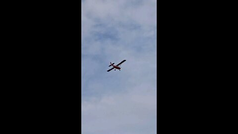 Small plane glides over the lake