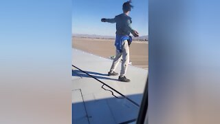 Police identify man accused of climbing on airplane in Las Vegas