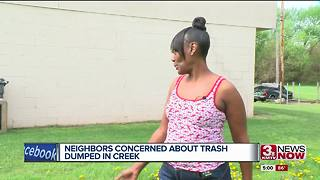 Neighbors concerned about trash dumped in creek