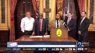 Acting Mayor Jack Young signs two bills into law