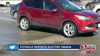 Drivers maneuvering mass potholes on major streets
