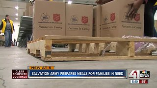 Salvation Army volunteers make Christmas meal kits for families
