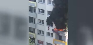 Children jump from window to escape fire