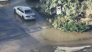Water main break causes flooding on Englewood street, yards