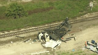 3 hurt after train hits truck in western Palm Beach County