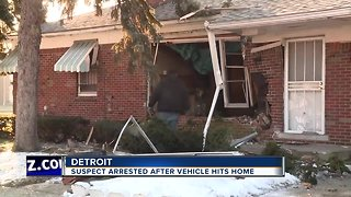 Suspect arrested after vehicle hits home in Detroit
