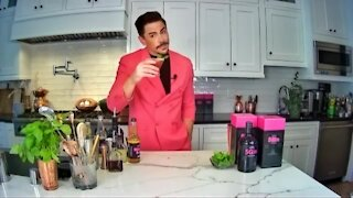 Celebrity mixologist with a cocktail recipe using T-Mobile 5Gin