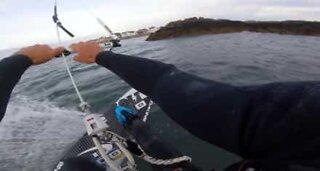 Kitesurfer performs awesome tricks over dangerous rocks