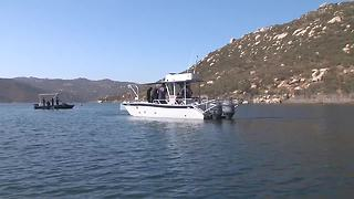 36 divers search reservoir for girl