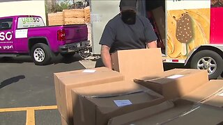 Frozen yogurt truck being used as a mobile food bank to serve Coloradans in need