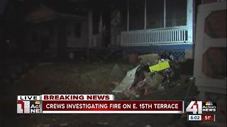 Woman rescued from house fire