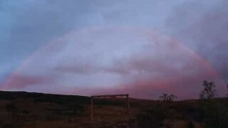Beautiful rainbow forms after midnight