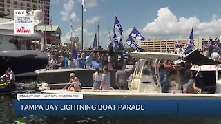 Coach Cooper hoists Stanley Cup during boat parade