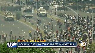 Locals closely watching unrest in Venezuela