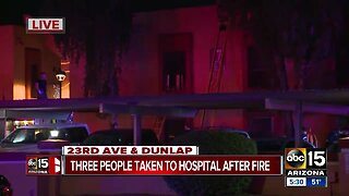 Three people taken to hospital after apartment fire