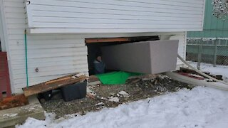 Homeowners have to remove entire window to fit couch into basement