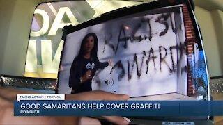 Good Samaritans help cover graffiti