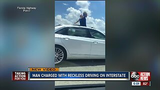WATCH: Fla. driver caught standing through moon roof