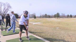 Golfers enjoy warmer weather