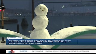 Crews treating roads in Baltimore City
