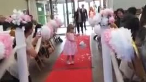 Flower girl repeatedly stops to blow kisses