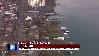 Police officer in kayak rescues woman from sinking car in Detroit River
