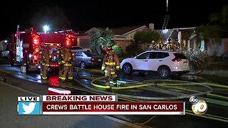 Crews battle house fire in San Carlos