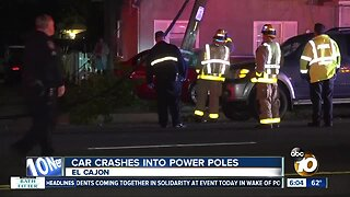 Car crashes into power poles, leaves lines dangling