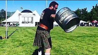 Man beats world keg-tossing record!