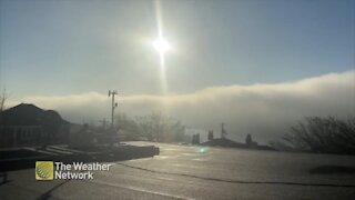 Beaming sun illuminates massive cloud over water