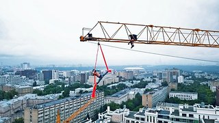 Husband And Wife Take To The Skies And Rivers Of Russia To Perform Amazing Pole Dances In The Most Dangerous Of Places
