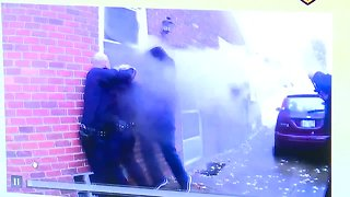 Body cam video shows Dearborn police officers work to rescue woman from burning home