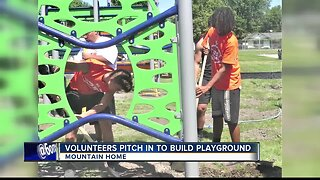 Volunteers help build first-ever playground for Mountain Home school