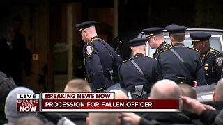 Fallen officer arrives downtown after police procession